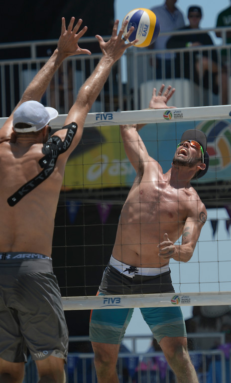 . Nick Lucena spikes the ball against Theo Brunner in pool play of the World Series of Beach Volleyball Friday, July 14, 2017, Long Beach, CA.  Nick Lucena and Phil Dalhausser defeated Theo Brunner and Casey Patterson in two sets. (Photo by Steve McCrank, Daily Breeze/SCNG)