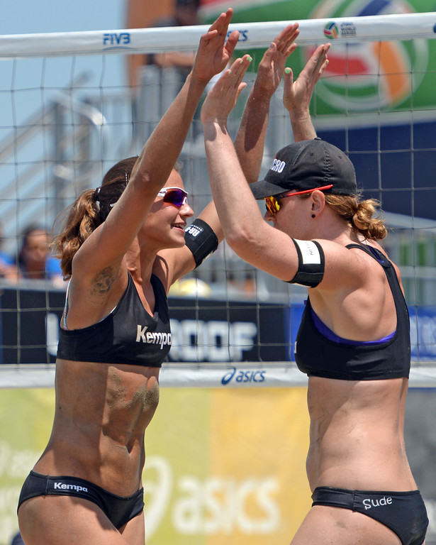 . Germans Chantal Labourer, left, and Julia Sude, right, celebrate a point in quarterfinals of World Series of Beach Volleyball Friday, July 14, 2017, Long Beach, CA.  Labourer and Sude lost to Brazilians Larissa and Talita. (Photo by Steve McCrank, Daily Breeze/SCNG)