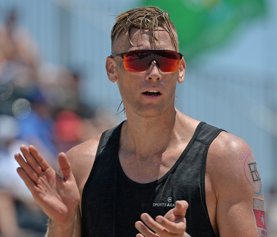 . Casey Patterson pumps up teammate The Brunner in pool play of the World Series of Beach Volleyball Friday, July 14, 2017, Long Beach, CA.  Nick Lucena and Phil Dalhausser defeated Theo Brunner and Casey Patterson in two sets. (Photo by Steve McCrank, Daily Breeze/SCNG)