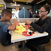 McDonald's held a ribbon cutting for their newly remodeled North Main Street location on Friday morning. Enjoying the new place is siblings Samuel Kjwofie, 9, and Mary Kwofie, 21. SENTINEL & ENTERPRISE/JOHN LOVE