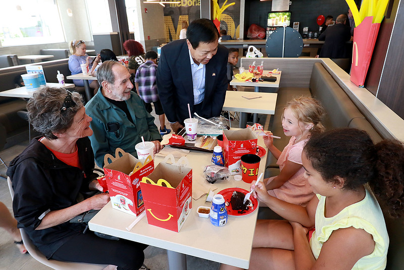 McDonald's held a ribbon cutting for their newly remodeled North Main Street location on Friday morning. Owner David Yee chatted with customers after the ribbon cutting. Clockwise from left is Jerry Breen, Oscar Duncan, Alyssa Breen, 8, and Lucy Kimball, 7.  SENTINEL & ENTERPRISE/JOHN LOVE