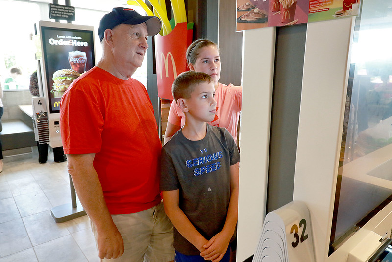 McDonald's held a ribbon cutting for their newly remodeled North Main Street location on Friday morning. Using the new  Kiosk is Dennis Spinelli with his kids Rocco Spinelli, 8, and Kassandra Spinelli, 14, all of Leominster. SENTINEL & ENTERPRISE/JOHN LOVE