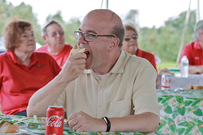 U.S. Congressman Jim McGovern was in the area on Wednesday doing his 2018 Farm Tour. He was discussing the 2018 farm bill and highlighting the uncertainty facing farmers following President Donald Trump's Administration's Tariffs. McGovern visited Sholan Farms in Leominster around noon during his tour. McGovern enjoys a Sholan Farms apple during the luncheon after a tour of the property. SENTINEL & ENTERPRISE/JOHN LOVE