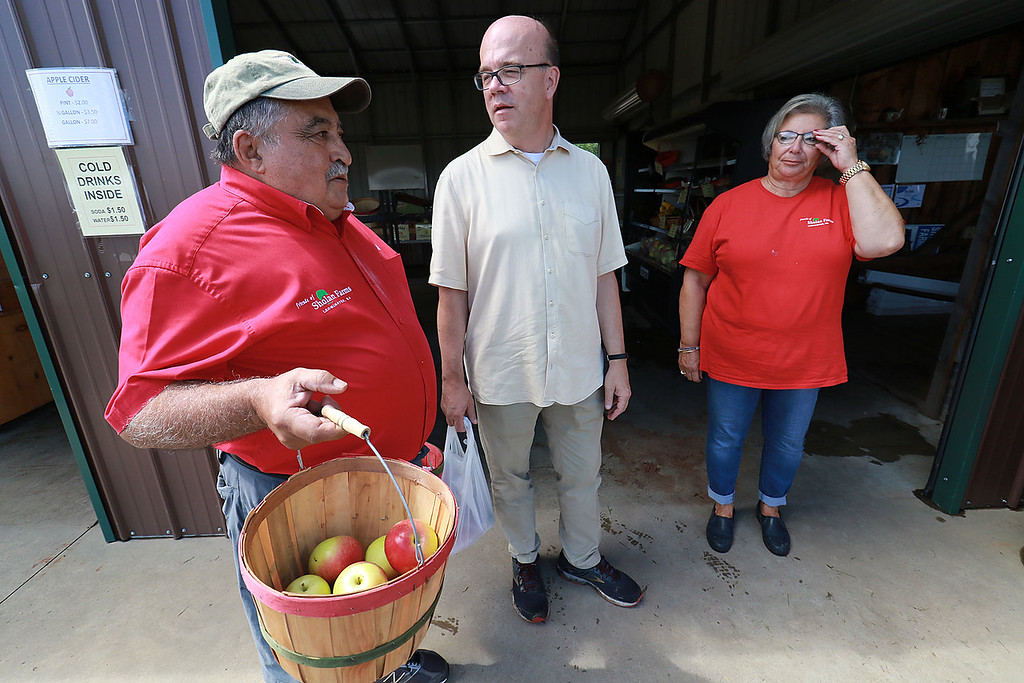. U.S. Congressman Jim McGovern was in the area on Wednesday doing his 2018 Farm Tour. He was discussing the 2018 farm bill and highlighting the uncertainty facing farmers following President Donald Trump\'s Administration�s Tariffs. McGovern visited Sholan Farms in Leominster around noon during his tour. McGovern chats with Sholan Farms board members John Souza and Patricia LaGrassa during his visit. SENTINEL & ENTERPRISE/JOHN LOVE