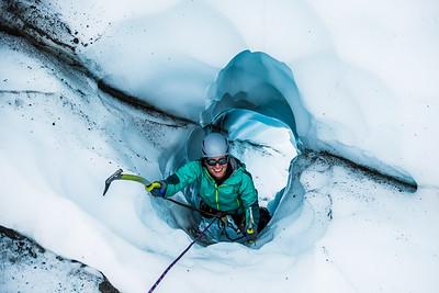 Active woman ice climbing on the Matanuska Glacier in Alaska