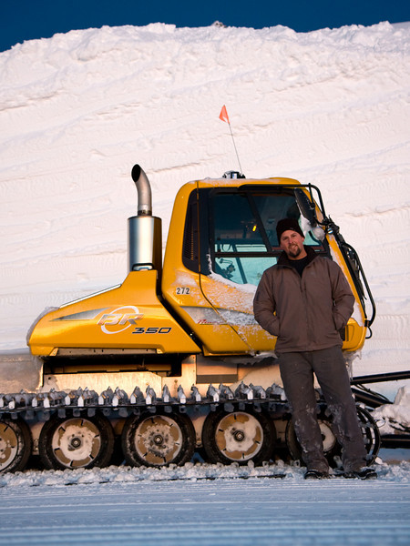 Me, my snowcat and the 18' high cut wall I'd just made as part of a project at work.<br /> <br /> Location: Bottom of Dallas Bowl, Mt. Hood Meadows ski area, Oregon<br /> <br /> Lens used: 17-55mm f2.8 IS