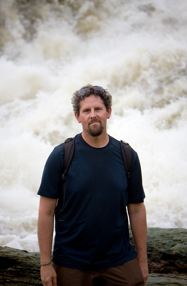 The raging whitewater of the Nile river as it enters the 7 meter-wide gap of Murchison Falls makes a fine background for my ugly mug.<br /> <br /> Location: Murchison Falls National Park, Uganda<br /> <br /> Lens used: 24-105mm f4.0 IS