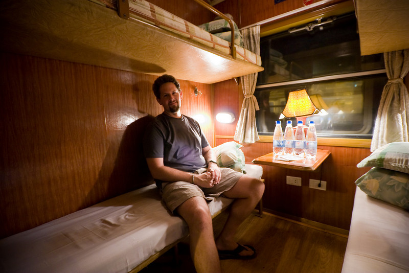 Me, getting settled in for an overnight train trip from Hanoi to Lao Cai (the railhead for Sapa).<br /> <br /> Location: Hanoi, Vietnam<br /> <br /> Lens used: 10-22mm f3.5-4.5