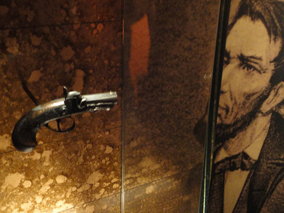 leads a tour of the refurbished museum (pictured is the one-shot derringer used to kill Lincoln) ...
