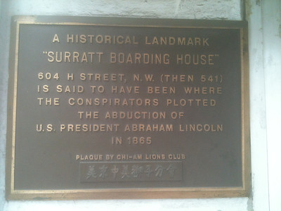 "A plaque mounted on the wall outside the ""Wok-n-Roll."""