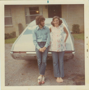 Helmet-haired hippie with cigarette, bowling shoes, barefoot and pregnant sister, 1971.