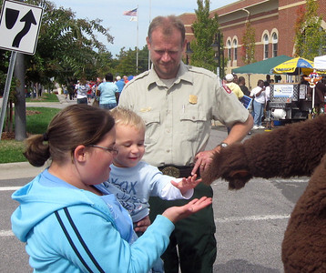 A young forest fire preventer meets Smokey.