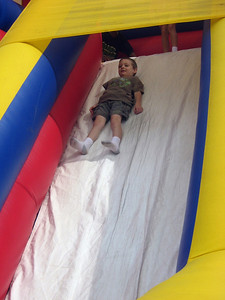 Activities for all--kids enjoy an inflatable slide.