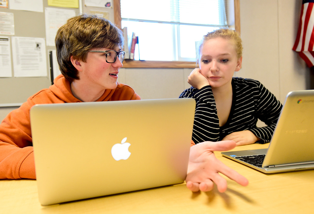 . From left: Mead High School sophomores Blake LaVanchy and Kassidy Trembath talk about a story during Newspaper Class in Mead, Colorado on Oct. 5, 2017.  (Photo by Matthew Jonas/Times-Call)