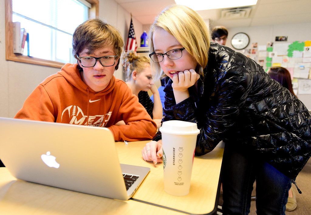 . From left: Mead High School sophomores Blake LaVanchy and Shelby Lewis work during Newspaper Class in Mead, Colorado on Oct. 5, 2017.  (Photo by Matthew Jonas/Times-Call)