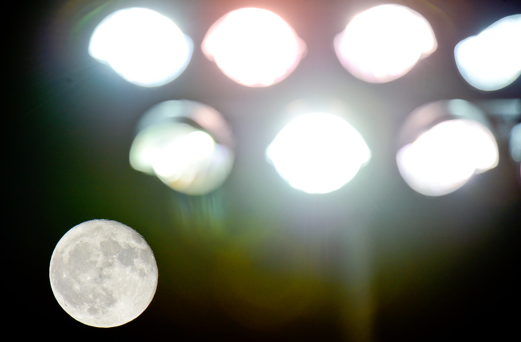 . The moon provided some additional light during the Mead High School and Roosevelt High School football game in Mead, Colorado on Oct. 6, 2017.  (Photo by Matthew Jonas/Times-Call)