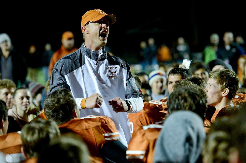 . Mead High School\'s coach Jason Klatt celebrates with the team after defeating Roosevelt High School in Mead, Colorado on Oct. 6, 2017.  (Photo by Matthew Jonas/Times-Call)