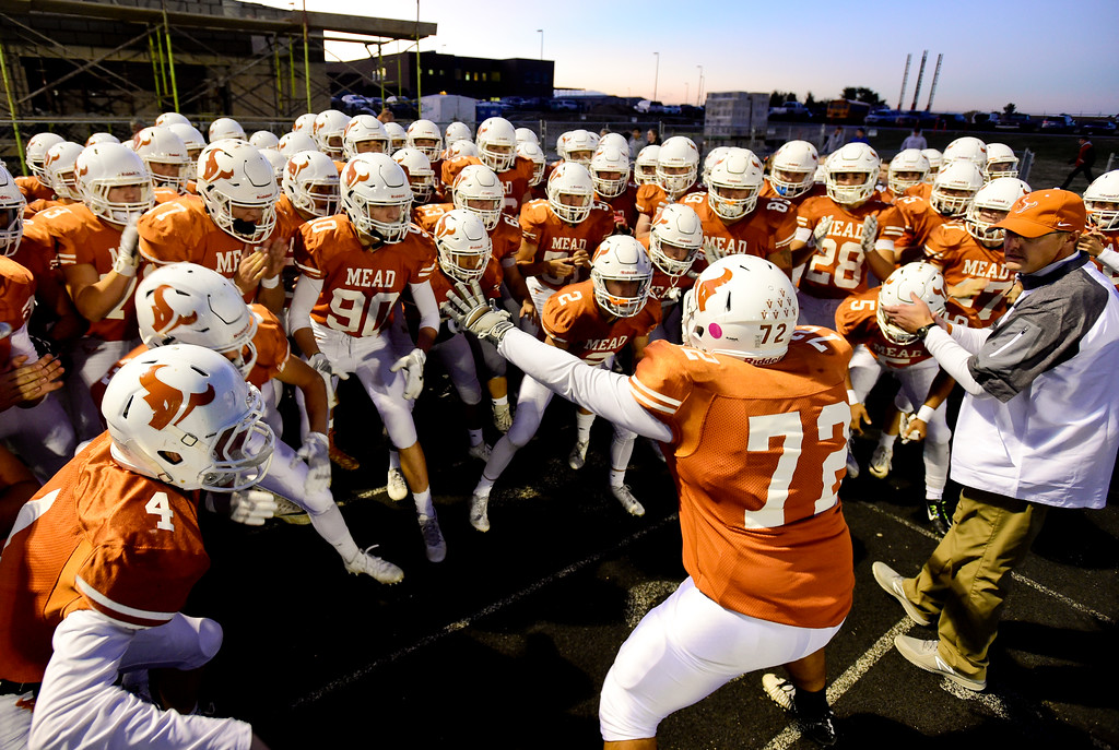 . Mead High School\'s Luis Miramontes (No. 72) gets the team fired up before they take the field against Roosevelt High School in Mead, Colorado on Oct. 6, 2017.  (Photo by Matthew Jonas/Times-Call)