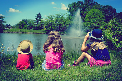 A day at Meadow Lark Botanical Gardens in Fairfax, Virginia, I managed this shot of children taking in the view by the pond. It is post-produced with Pixelmator for that vignette effect of an old photograph of lazy summer days gone by.
