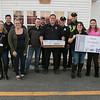 Montachusett Regional Vocational Technical School senior Meggan Law, 17, delivering Thanksgiving meal to fire departments on Tuesday afternoon. Westminster Firefighter Jason Cox holds the box of food dropped of by Law, second from right, holding sign. with her holding sign is her mom Jenn Janda-Law and her sister Abbie, 13 far right. On left in front is staff members of Monty Tech Nicole Noel and Brittany Brassard who were helping to deliver the food to all of the fire department. with all of them are members of the Westminster Fire and Police Departments. SENTINEL & ENTERPRISE/JOHN LOVE