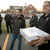 Montachusett Regional Vocational Technical School senior Meggan Law, 17, delivering Thanksgiving meal to fire departments on Tuesday afternoon. Westminster Firefighter Jason Cox is all smiles as he holds the box of food that law dropped off. SENTINEL & ENTERPRISE/JOHN LOVE
