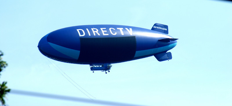 Direct Zeppelin: This week was a weird week for aircraft over my house. Aside from the flurry of planes in and out of Boston, there was a helicopter hovering over my house Tuesday (I hope they weren't looking for me....again) and today the Directv blimp. I wonder if I'll see an alien spacecraft tomorrow.
