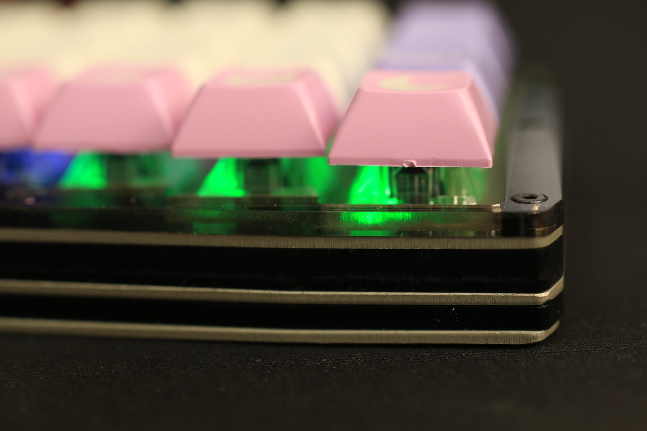 Only 12.5mm from the bottom of the keyboard to switch plate. To put it into perspective:<br /> <br /> - Whitefox: 12mm<br /> - TEX aluminum case + Sentraq S60X plate: about 12.5mm<br /> - Planck: 13mm<br /> <br /> I can squeeze about 1mm of height if I use thinner aluminum for middle and bottom plates. But getting plates in two different thickness for small scale projects is not economical, at least from my perspective. Using thinner plates could mean some countersinking will need to extend to the acrylic parts.<br /> <br /> It is probably possible to squeeze 0.5mm from the upper chamber if I can find acrylic sheets in 4.5mm thickness. If going that route, then it will be necessary to replace the 5mm M2 hex spacers with 4mm ones.<br /> <br /> If a thinner battery is available, then it should be possible to reduce bottom chamber to match the thickness of the battery.<br /> <br /> If thinness is paramount, then it is possible to forego battery and piezo buzzer; remove bottom chamber and make the middle plate the bottom plate. I can get 8mm bottom to switch plate thickness. And this is still not including the optimizations above. It may be necessary to remove the protruding JST-PH battery connector from the Adafruit controller, but if rubber feet are being used and they are in adequate height, then it might not be required.<br /> <br /> The faceplate is 3mm in height, but it doesn't add to overall height (it sits on the switch plate). So, it is not critical to optimize thickness here, but thinner acrylic mirrors are available, though choices of colors are far more limited.