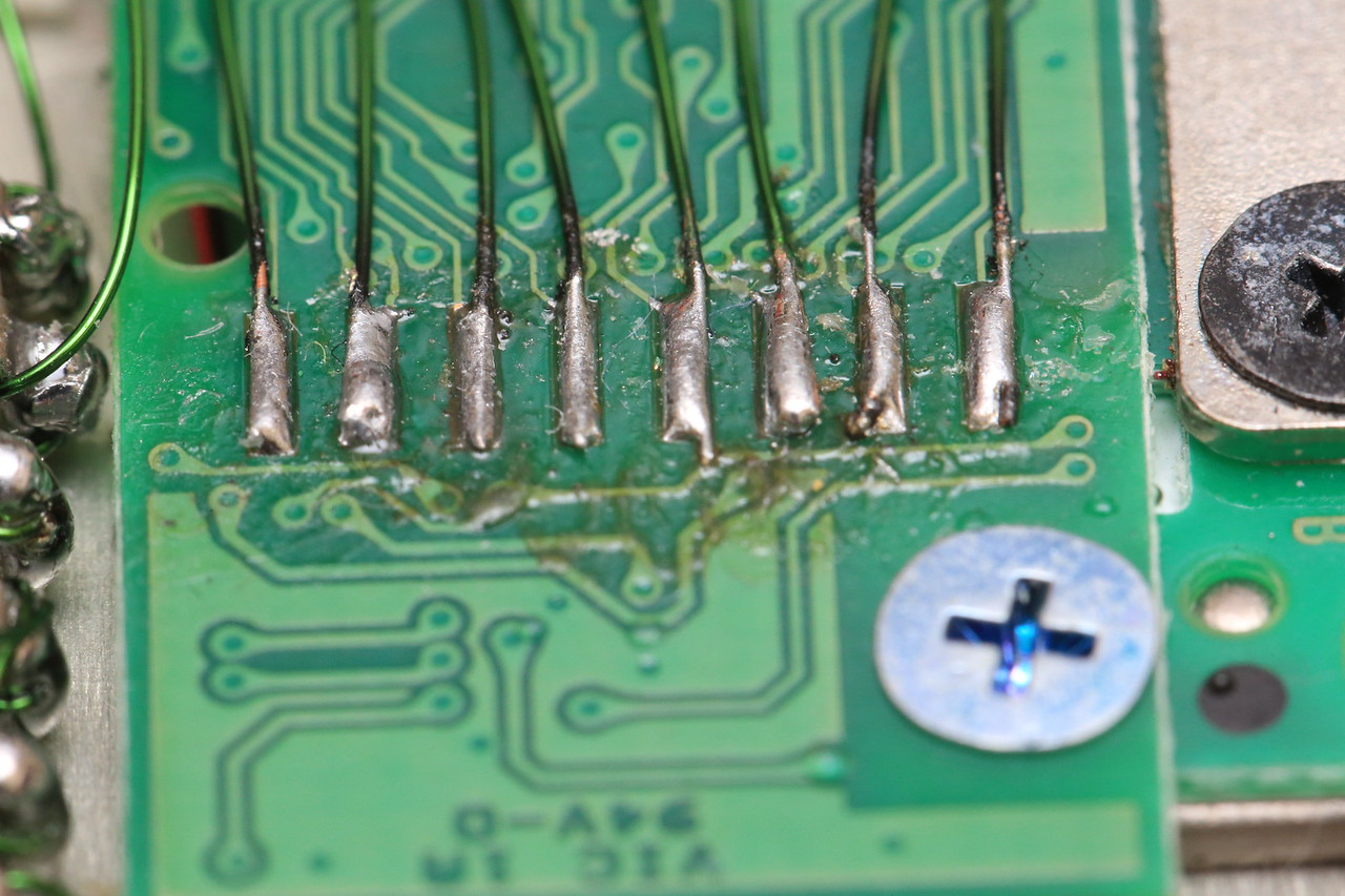 My 31337 soldering skillz. This is the bottom of Trackpoint module. I connected each pin using 32AWG magnet wire. I'm using the same magnet wire almost everywhere else.