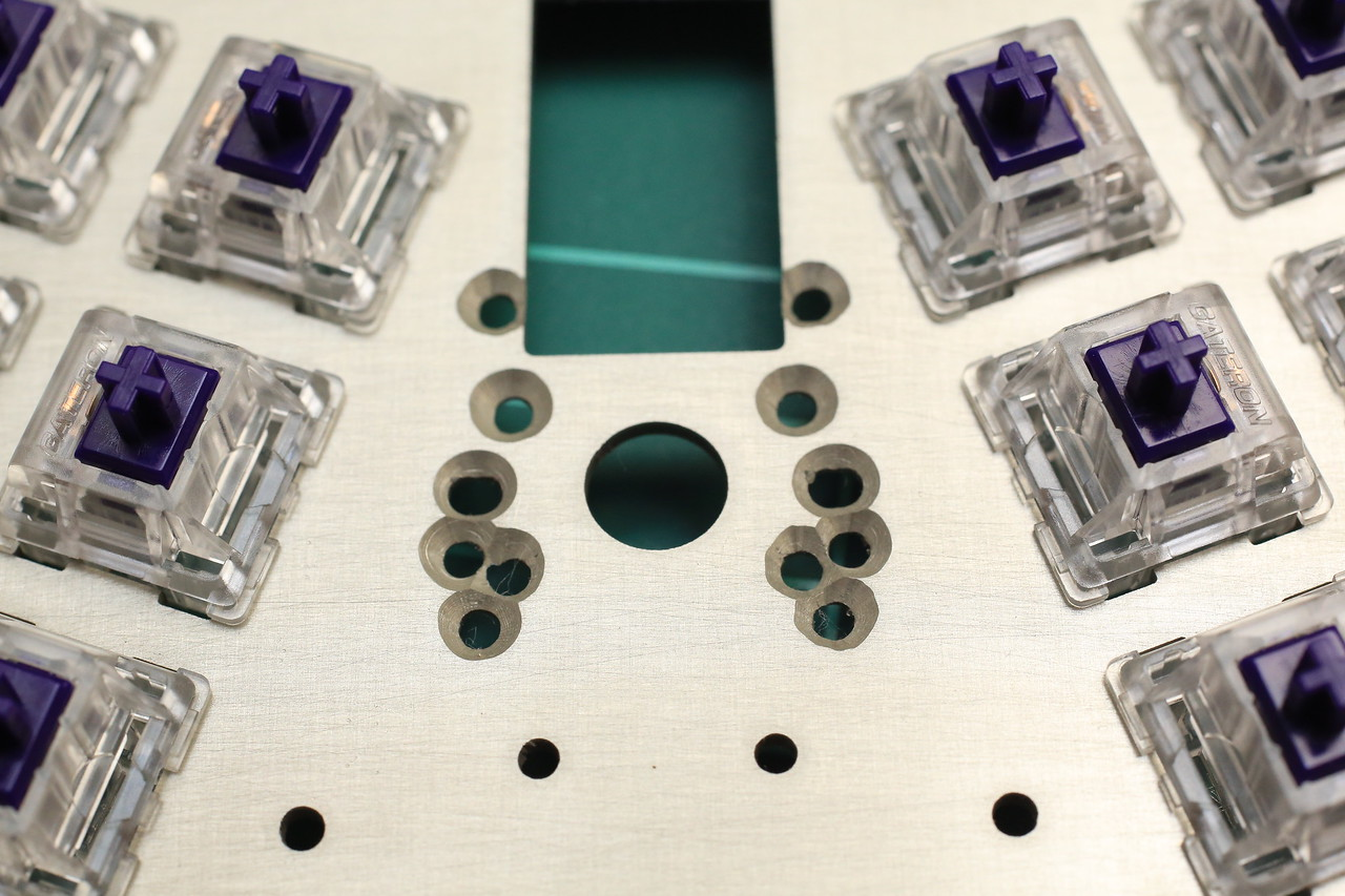 Trackpoint mounting screw holes. This should accommodate every Trackpoint module variations out there.<br /> <br /> Ugly countersinking job there. Probably will need to use drill press on overlapping holes for more consistent result.