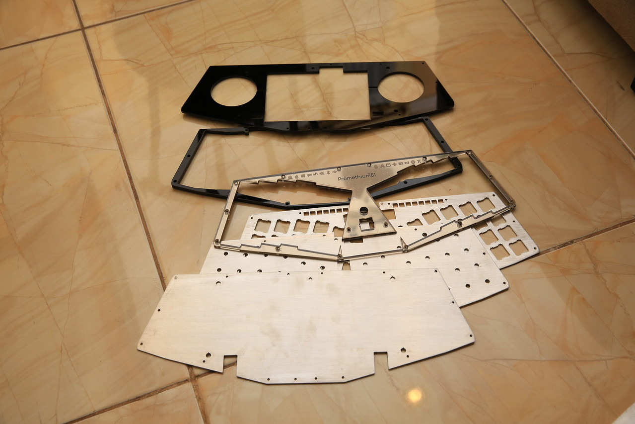 6 layer of plates from laser cutting shop. One acrylic mirror, 3 aluminum plates, and 2 black acrylic plates.<br /> <br /> Aluminum plates are going to be anodized for electrical insulation, as it will be really tight inside the keyboard.