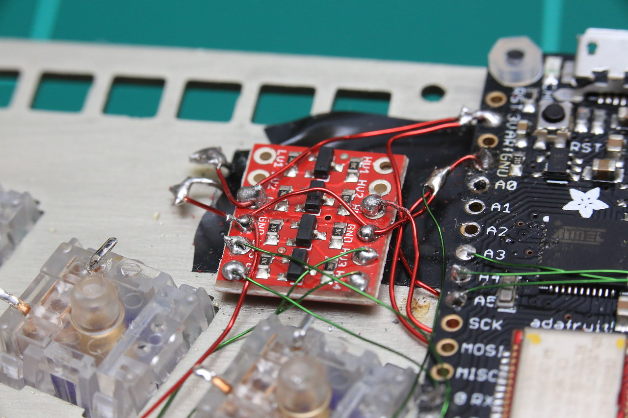 This converts signal from 3.3V to 5V and back again. It sits between the Adafruit controller and Trackpoint module, and later the RGB LED strip bus.<br /> <br /> The Adafruit LED backlight module is also now connected to 3.3V.