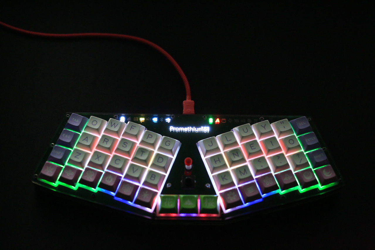 There's an RGB LED under each switch, inclucing Trackpoint buttons. Switch LEDs and indicator LEDs are connected in a single WS2812/SK6812 bus.