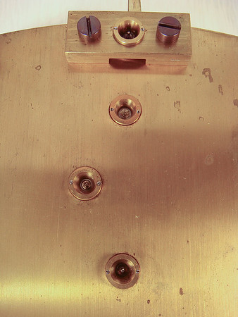 Close-up of the 4 jewels and their settings on the back plate of the mechanism