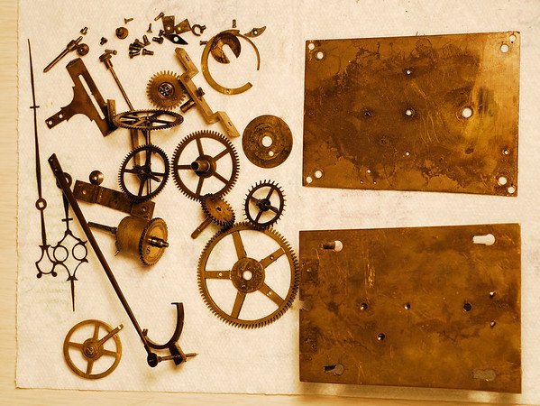 The mechanism in pieces before cleaning.