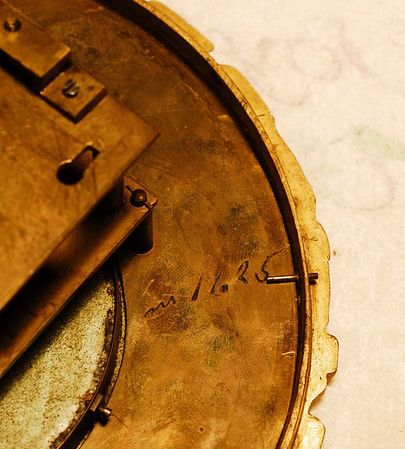 Number on the back of the dial pan - A makers note to remeber a measurement, preserved when the ink etched the brass?