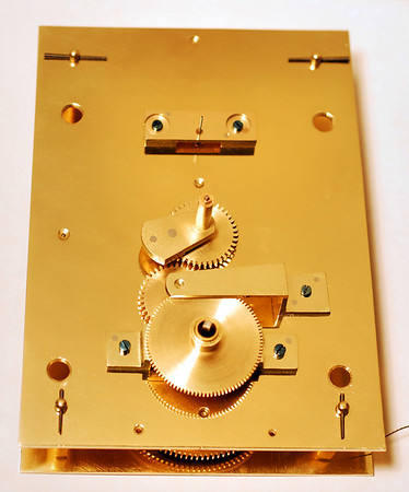 Layout of a mechanism with an Astronomical Dial.  Note the counterbalance on the minute cannon pinion!
