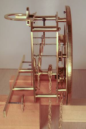 Side view of completed mechanism showing mechanism hanger and stabilizing screws