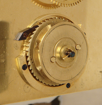 Detail shot of the idler cog on the front plate.