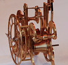 "This clock is a replica of the STRUTT EPICYCLIC TRAIN CLOCK <br /> <br /> This is one of the most interesting of all single train skeleton clocks ever conceived. First made by an Englishman, William Strutt, it has a number of interesting and extremely unusual features not found in other clocks. Its 8-day run, spring driven train is epicyclic (planetary gearing) and involves a ring wheel of 4-1/2"" ID and 5-1/2 OD teeth. The motion work is based on the Ferguson Mechanical Paradox instead of the normal 12 to 1 gear train. To allow individual setting of the hands, the collets are of most unusual design. Both beautiful and unusual in the extreme, this clock is an excellent time keeper.<br /> <br /> The center arbor carries the minute hand and is driven by a fusee/great-wheel assembly. Fixed to the center arbor is a a planet arm having a counterweight on one end and a planet wheel and pinion on the other end. A sun wheel is fixed to the dial and cannot rotate. The planet pinion engages this wheel and is forced to rotate while being moved around it by the planet arm. The planet wheel drives the internal teeth of the ring wheel, which is free to rotate on the center arbor. The external teeth of the ring wheel drive the escape wheel pinion. A conventional recoil escapement drives the pendulum.<br />   <br /> William Strutt designed his epicyclical geared clock in the late 1820's and his friend William Wigston built it. Because of the difficulties involved in making epicyclical gears very few were made by Strutt and Wigston. The visual fascination of epicyclical gearing (also more commonly referred to as 'sun and planet gearing') has subsequently inspired many copies of the clock. This style was made in a limited edition of 100 between November of 1973 and February 1974 and were sold mainly to the United States for $3500. Epicyclical gearing has been used in orrerys and is extensively used in transmissions for all sorts of machinery, including automobiles.<br /> <br /> I give credit to  W.R.Smith for documenting this clock and publishing a book, ( How To Make A Strutt Epicyclic Train Clock)"