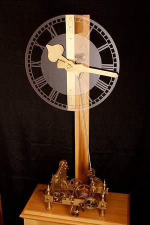 A small tower clock movement<br /> <br /> This particular clock was a joy to build it has a deadbeat escape with a one second pendulum. This clock makes an excellent example of a skeleton clock so one can view the gears and cams in the inner workings of a small tower clock. As a clock enthusiast, this particular clock took six months to construct and makes an excellent display in my home and has attracted a lot of attention and has been a great conversational piece. One   could say that this clock is an example of metal art in motion. This tower clock movement was designed by an Englishman by the name of John Wilding; again I say this clock has been a pure pleasure to build.