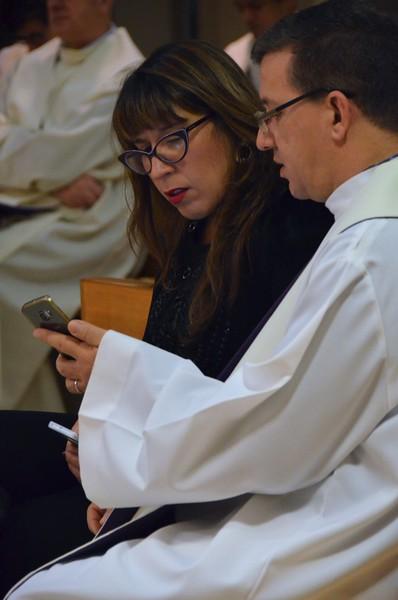 Sharing a smart phone instead of a prayer book!