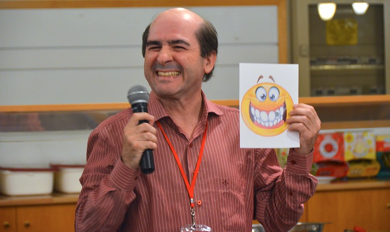 Fr. João Carlos Almeida tries to imitate his emoji during the opening night's ice-breaker