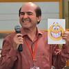 Fr. João Carlos Almeida tries to imitate his emoji during the opening night's ice-breaker