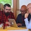 Representatives from Studio Otwarte, a design agency, meet with Fr. Radek