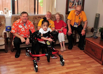 Greg English (Chairman of the Lions Children's Mobility Fund, District 201N), Cambridge Park Past President Charles Armstrong and wife Pat, Cambridge Park Lions President Alan Bideleux with Amiah-Grace Tuakalau Western News - 7th December, 2018