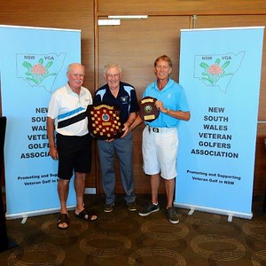 Runner-Up Laurie Cupples, NSWVGA Secretary Len Payne and 2018 Champion Ricky Allison with the perpetual and winner's trophies for the 2018 NSWVGA Stroke-Play Championships. The Senior Newspaper May editionl, 2018