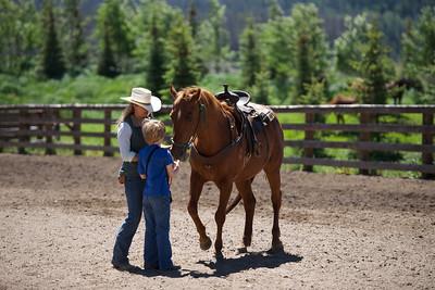 A young boy introduced to his horse at Vista Verde Ranch in northwestern Colorado.