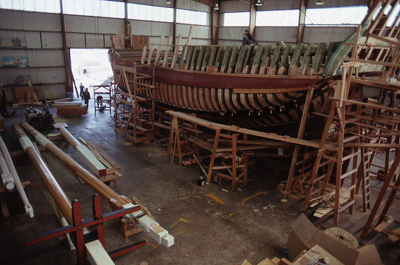 The Lady Washington under construction in Aberdeen, Wash. with her masts on the left. Her keel was laid on Sept. 13, 1987 and she was launched on March 7, 1989. Photo by Brandon Ford.