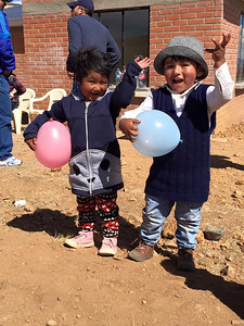 Two happy children who have new homes in Bolivia and are now protected from the dangerous Chagas bug.