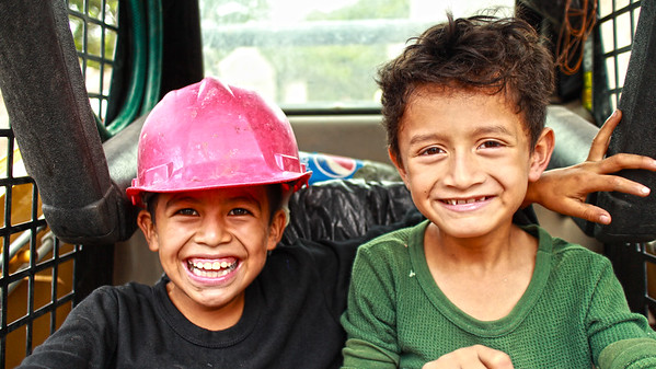 Two El Salvadoran boys are excited about helping build a new community.